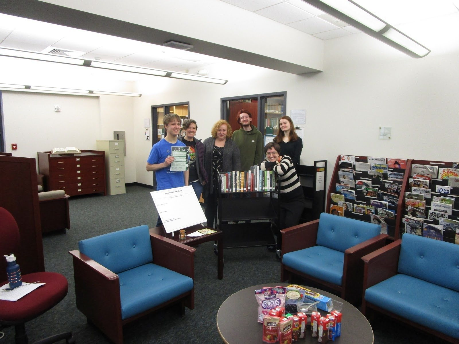 Librarians and Attendees to Story-Time Next to Book Cart - Library Story-Time: The Sound Machine - (Source - Caleb Lizon)