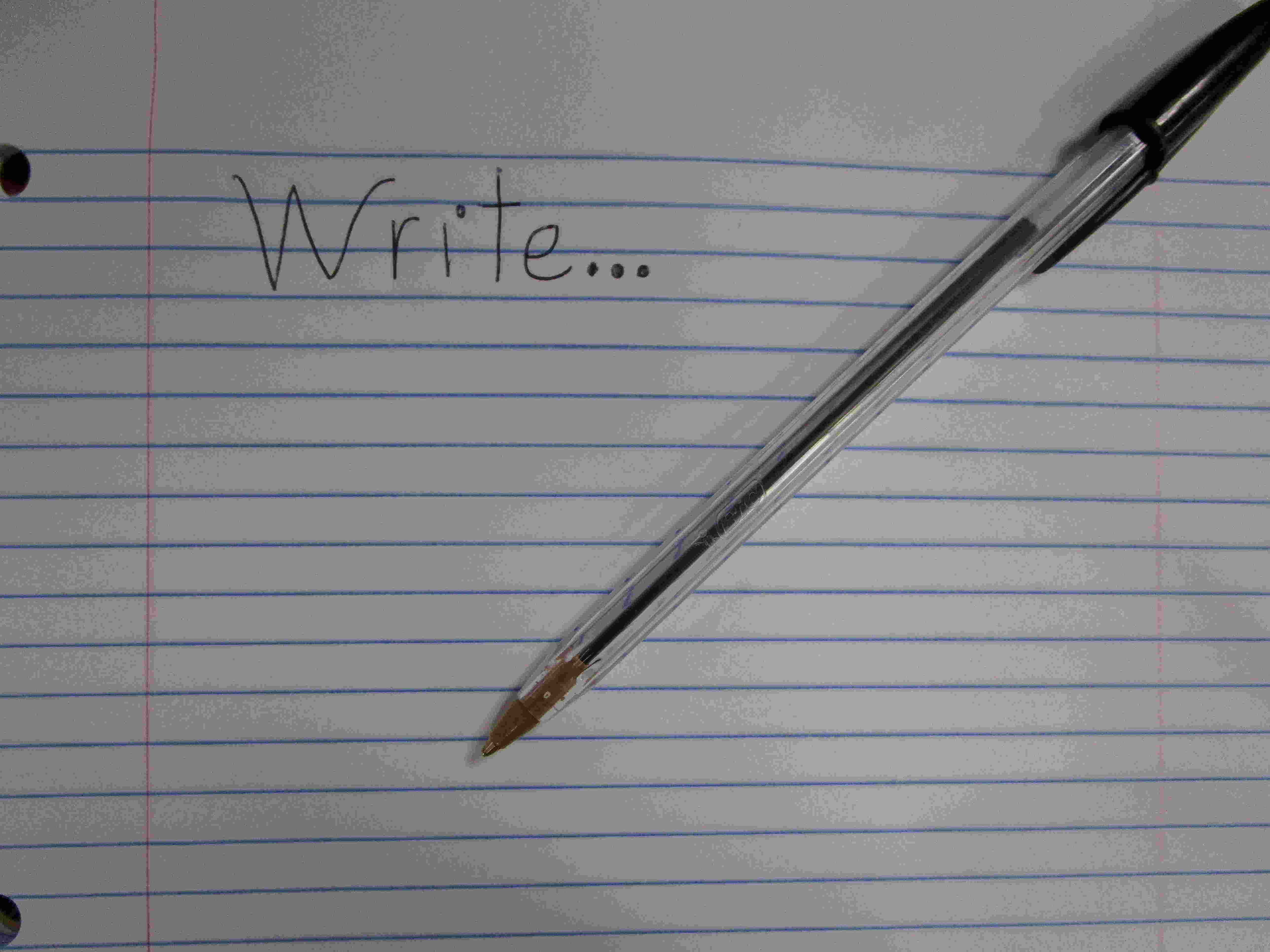 """A pen and paper with """"Write"""" written on it"""