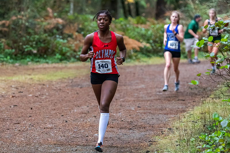 Rubijean Stuit of Olympic College Cross Country races at the NWAC Championships