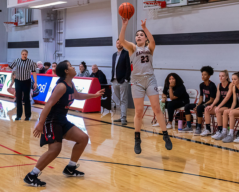 Olympic College women's basketball athlete, Isis Crew, shoots a three in a recent game.