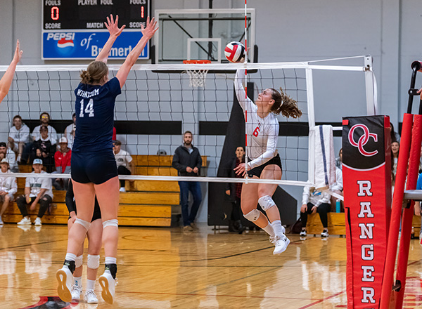 Katie Love from Olympic College Volleyball attacks a ball during a recent volleyball match.