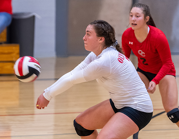 Freshmen volleyball athlete Mikkele Gallier passes a ball during a match.