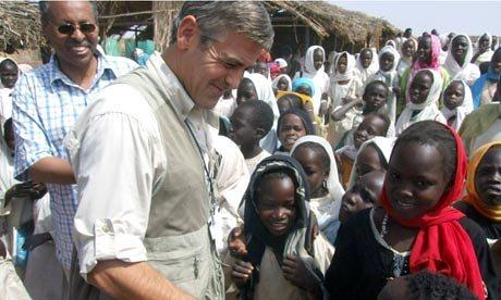 George Clooney surrounded by children
