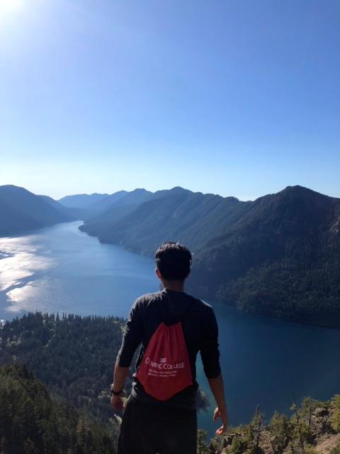 Photo of Res Hall Resident Mustaqim Rahman on a hike in the Olympic National Park