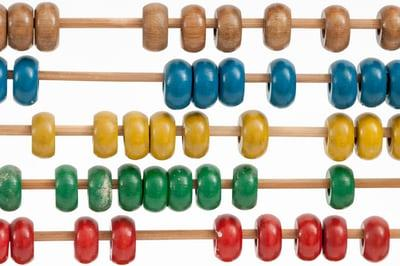 Colored beads on wooden dowels
