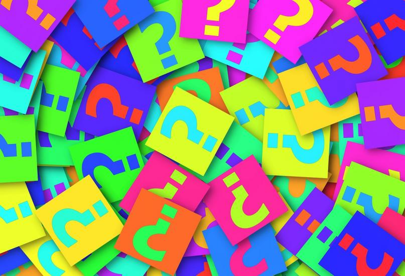 Pile of Question Marks on Colorful Post-Its