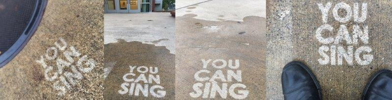 """Words """"You Can Sing"""" on pavement"""
