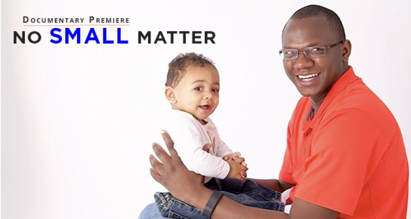 Documentary Premiere- No Small Matter - Picture of a smiling man holding a happy baby