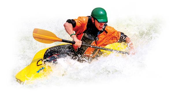 Person in kayak with paddle in white water rapids