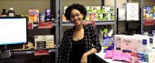 Student employee Dayonnah Harris is pictured in front of the Sheryl Mckinley Food Pantry.