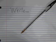 "A pen and paper with ""Write"" written on it"